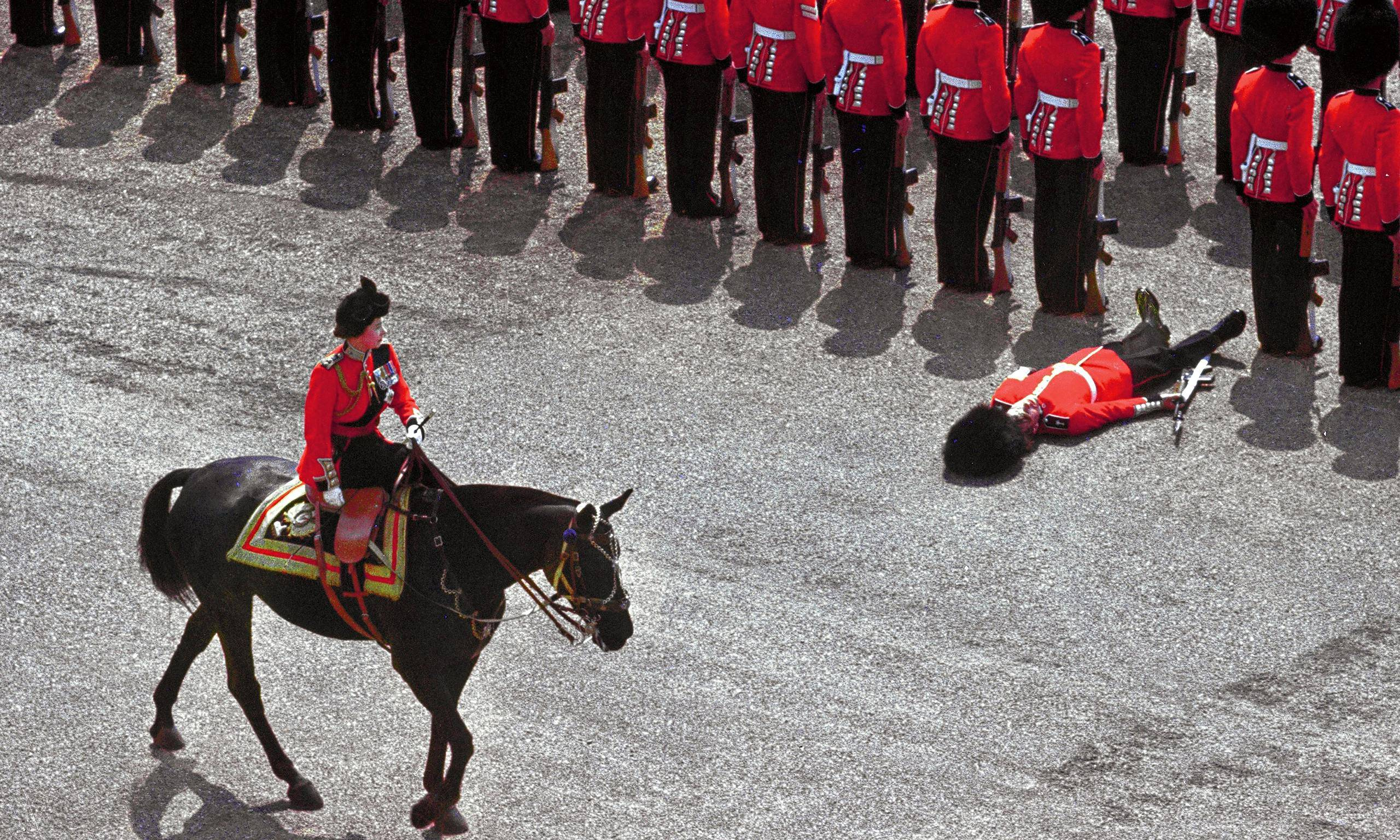 a-guard-of-honor-passes-out-as-queen-elizabeth-2-rides-past-during-the-trooping-the-colour-parade-1970