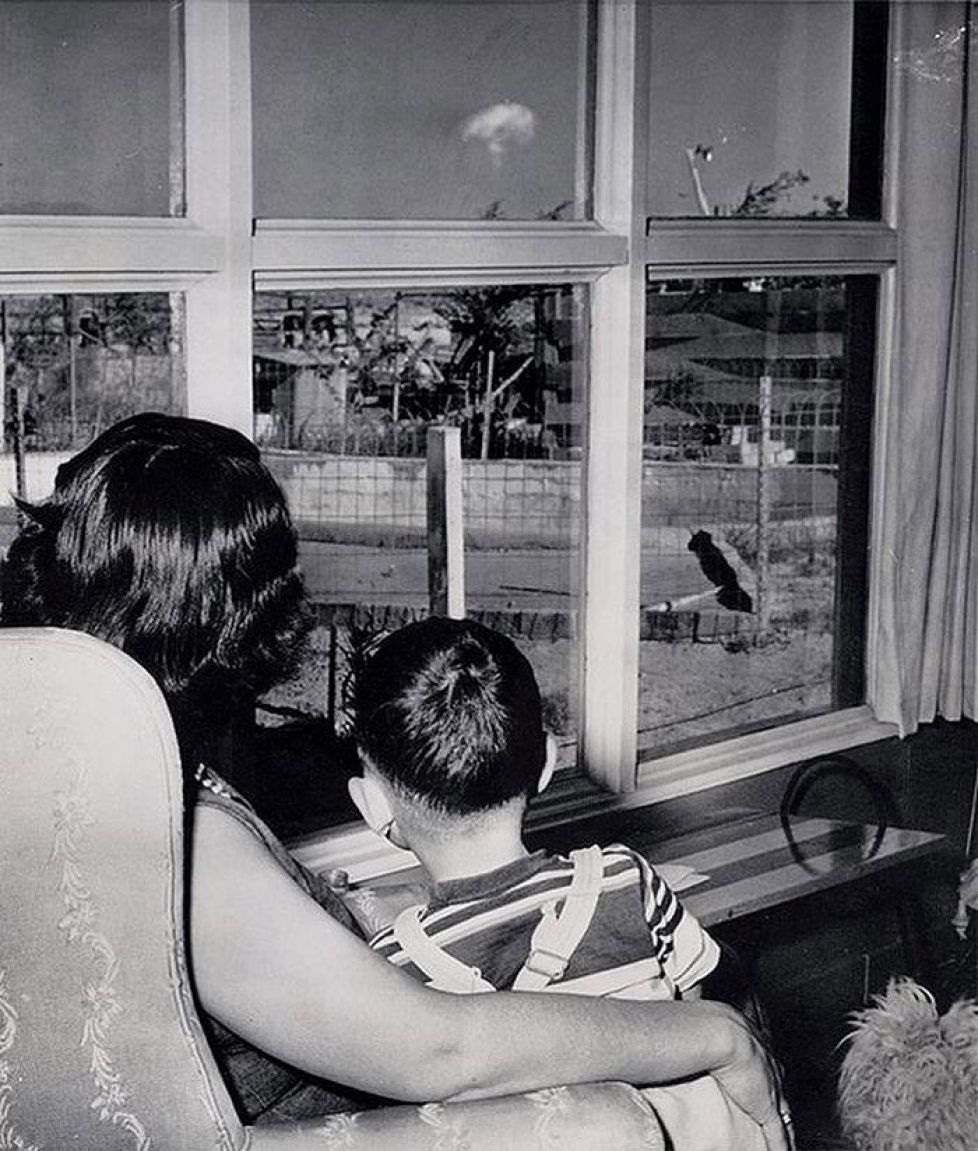 mom-and-son-watch the-mushroom-cloud-of-an-atomic-test-las-vegas-1953