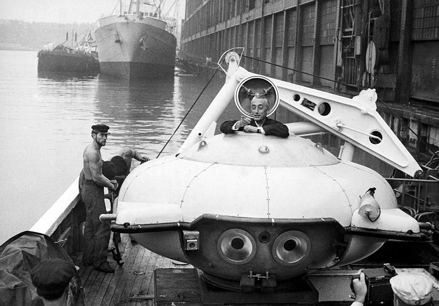 Jacques Cousteau climbing into his Diving Saucer on board the 'Calypso' docked in New York Harbor, August 1959