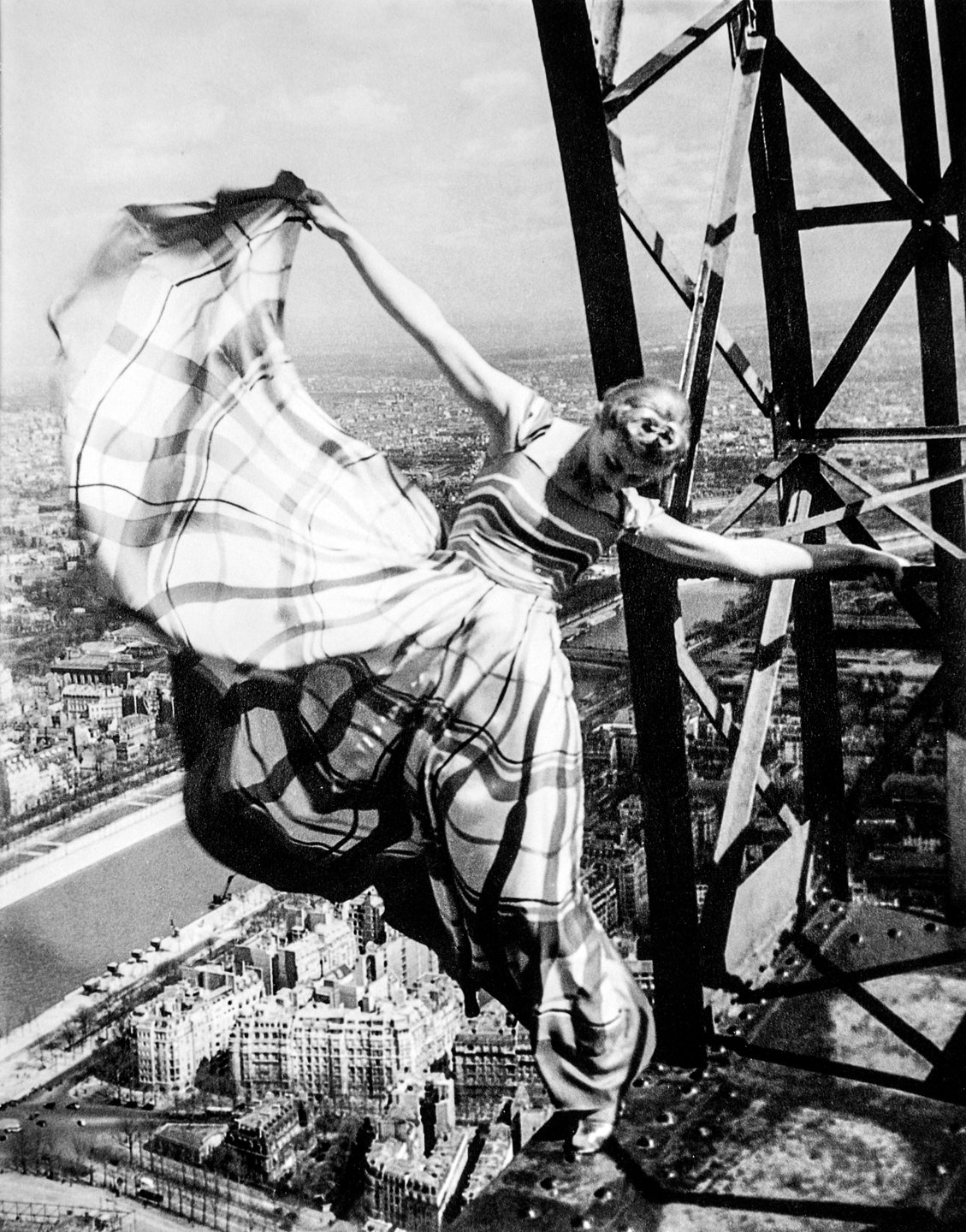 Lisa Fonssagrives on the Eiffel Tower, Paris 1939. Photo by Erwin Blumenfeld.