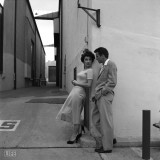 During a break in filming A Place in the Sun, Taylor chats with her costar Montgomery Clift on the Paramount lot. The two would remain close friends; she would even save his life in 1956, after he smashed his car into a telephone pole following a party at her house (Taylor removed his shattered teeth from his throat, and kept him from choking).