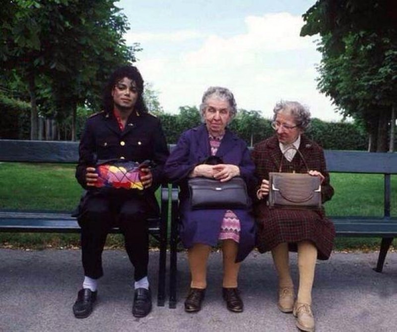 Michael Jackson with two old ladies on a bench in the park, 1985
