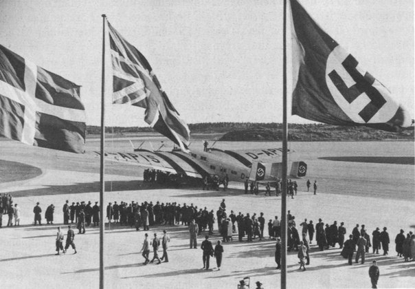 Opening ceremony of Bromma Airport in Sweden with the flags of Denmark, Great Britain and Nazi Germany. Bromma, Sweden 1936.