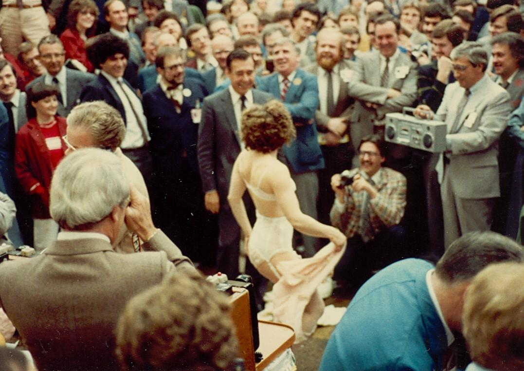 a-stripper-visits-the-trading-floor-of-the-toronto-stock-exchange-late-1970s
