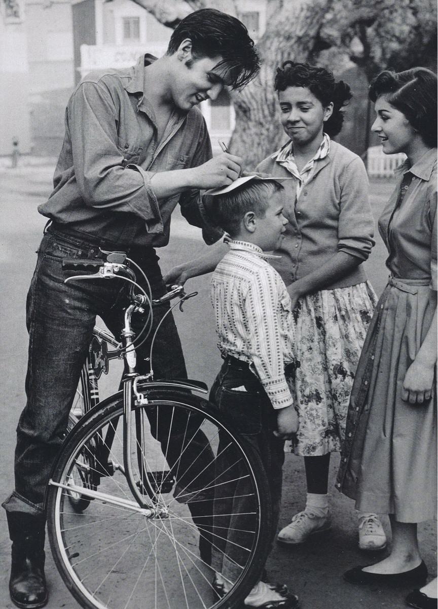 elvis-signing-autographs-on-a-boys-head-1959
