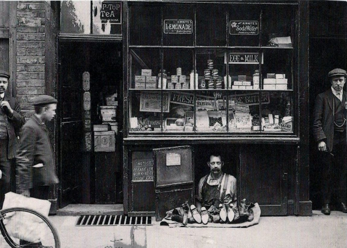 the-smallest-shop-in-london-a-shoe-salesman-with-a-1.2-square-meter-shoe-store-1900